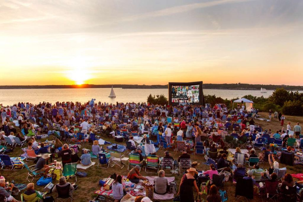 aquidneck outdoor film festival with sunset in background